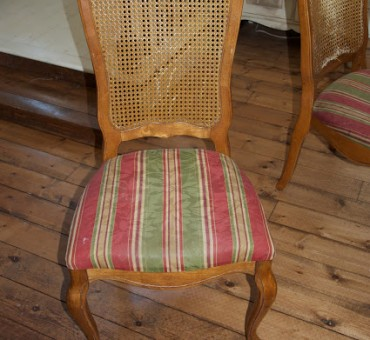 An Upholstered French Chair and a Pleated Skirt