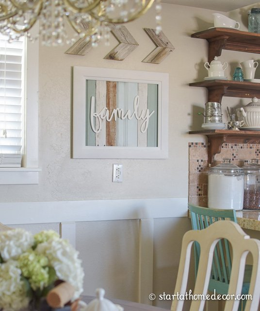 Reclaimed wood family sign by start at home decor. Beautiful farmhouse kitchen!
