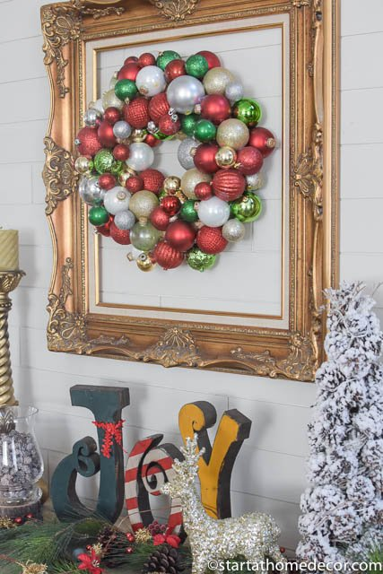 Decorate for christmas using a wreath