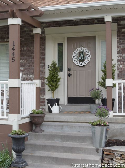 Adding this hello wreath to your front porch is a fun way to welcome your guest and add curb appeal!