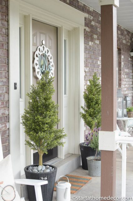 Adding Curb Appeal to Our Spring Front Porch | hello door hanger | Boxwoods | Farmhouse