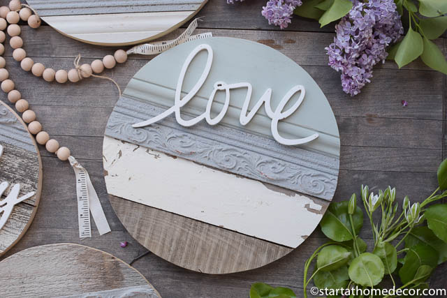 Reclaimed wood round with a love cutout.