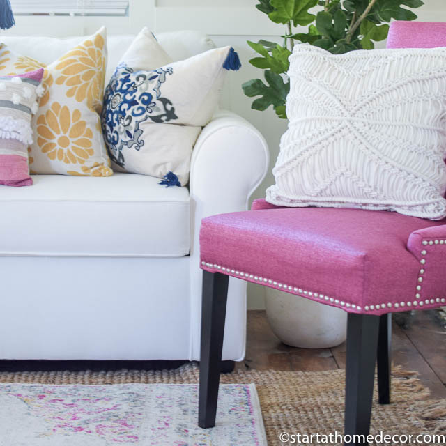 Neutral living room with accents in pink, navy and yellow