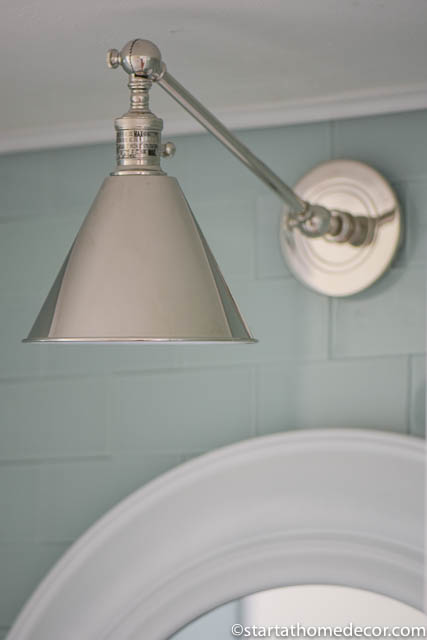 This wall sconces looks great over the mirror in our half bathroom