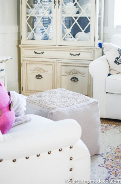 Hutch and pouf with accented rug