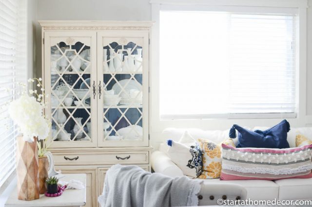 Neutral and navy hutch in living room