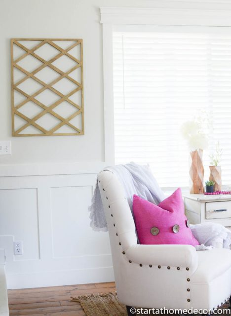 Wall decor and pink accents