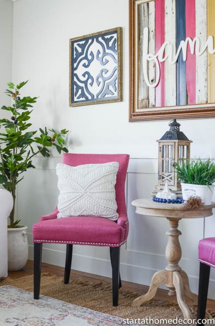 Pink, navy and yellow decor in my living room