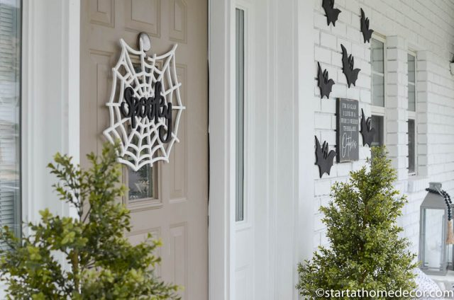 Spooky spider web and bats for Halloween front porch