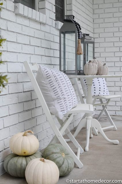 Black and white pillows for a Halloween front porch