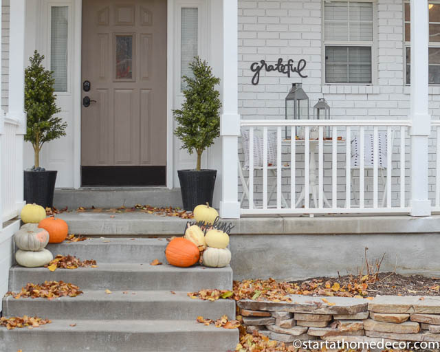 November porch with pumpkins and grateful