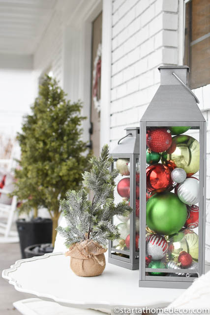 Use ornaments in creating a colorful Christmas front porch