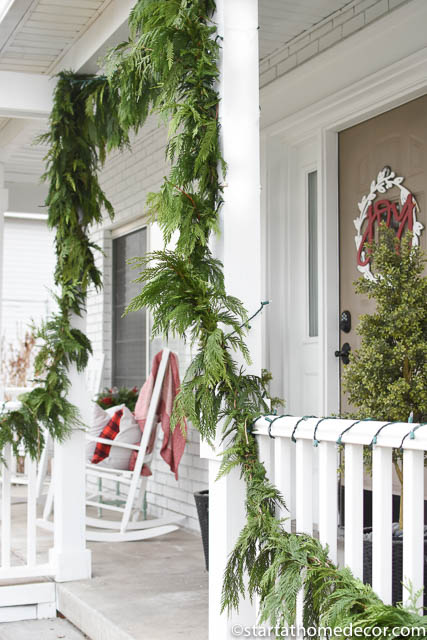 Use garland for your christmas front porch