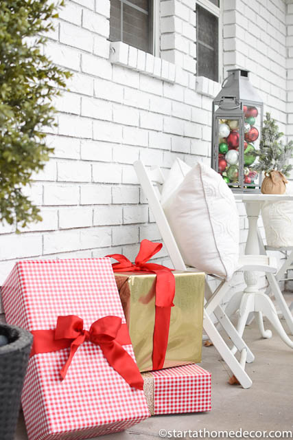 Create a budget friendly christmas front porch with wrapped gifts
