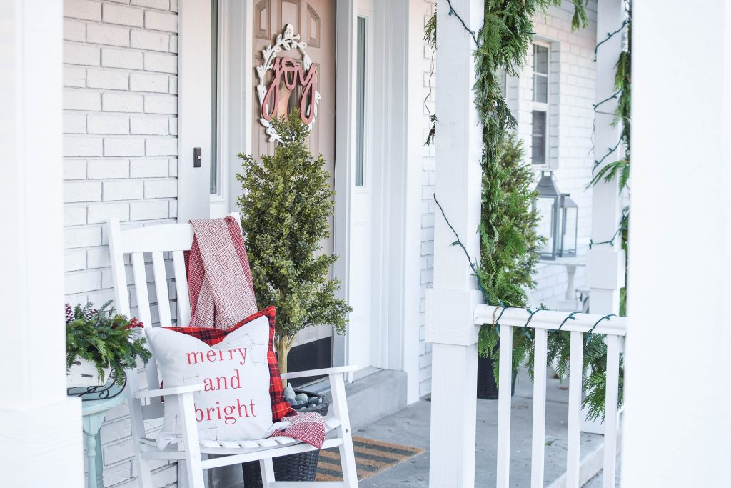 Toss pillows on your Christmas porch