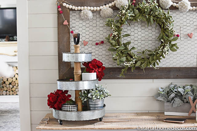 Use flowers in your stacked tray decor