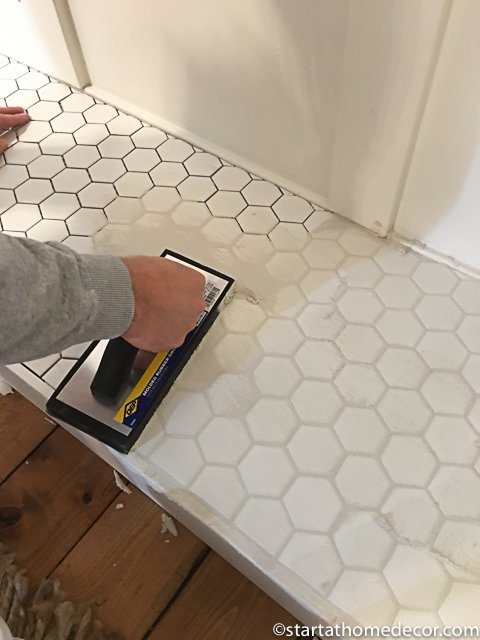 tile work on a faux fireplace