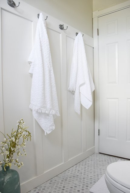 Bathroom towel hooks with wainscoting