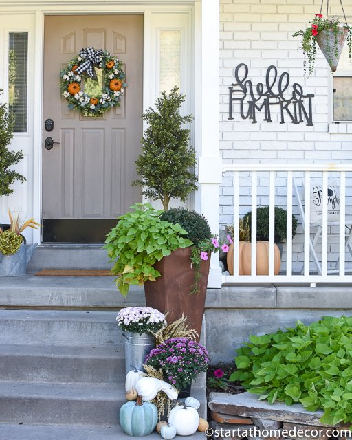 Fall porch pumpkin wreath