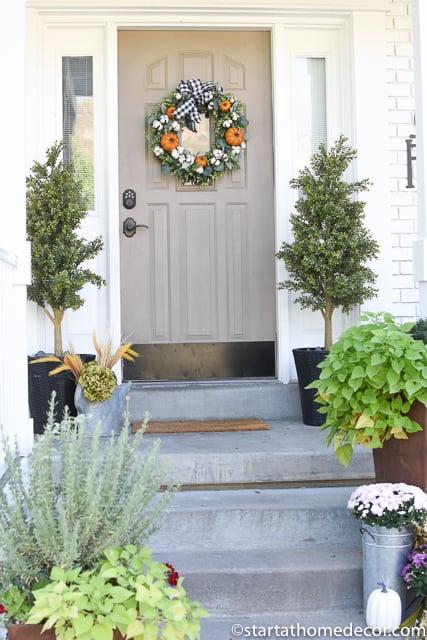 Fall porch pumpkin wreath