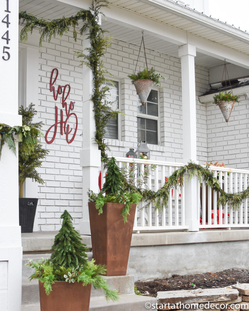 Elegant Christmas porch with greenery