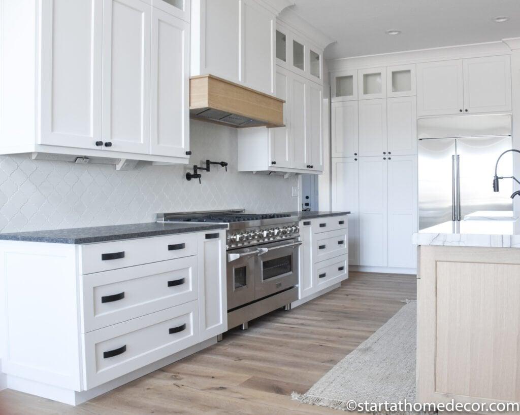 "48"" Oven | White Kitchen cabinets | Black countertops |start at home decor"